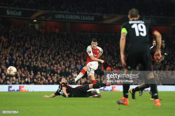 Granit Xhaka of Arsenal scores their 2nd goal during the UEFA Europa League Round of 16 2nd leg match between Arsenal and AC MIian at Emirates...