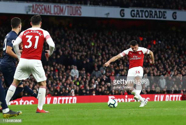 Granit Xhaka of Arsenal shoots at goal during the Premier League match between Arsenal FC and Manchester United at Emirates Stadium on March 10 2019...