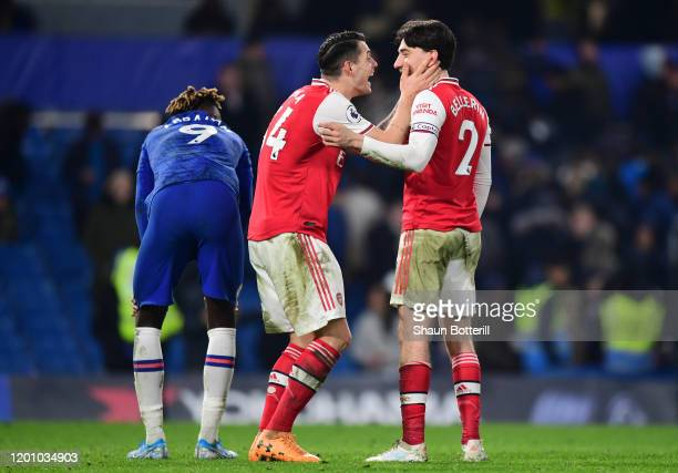 Granit Xhaka of Arsenal speaks to Hector Bellerin of Arsenal after the Premier League match between Chelsea FC and Arsenal FC at Stamford Bridge on...