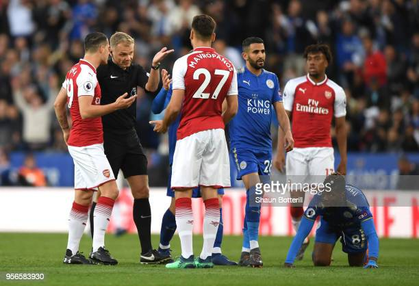 Granit Xhaka of Arsenal speaks with referee Graham Scott as Konstantinos Mavropanos of Arsenal appeals his innocent during the Premier League match...
