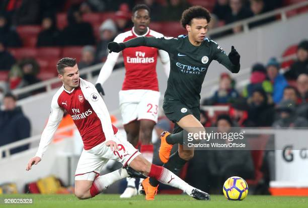 Granit Xhaka of Arsenal stretches to tackle Leroy Sane of Man City but fails to stop him during the Premier League match between Arsenal and...