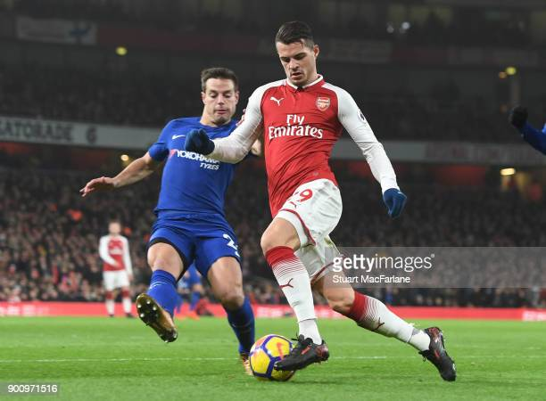 Granit Xhaka of Arsenal takes on Cesar Azpilicutea of Chelsea during the Premier League match between Arsenal and Chelsea at Emirates Stadium on...