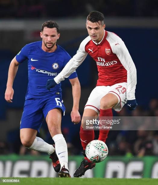 Granit Xhaka of Arsenal takes on Danny Drinkwater of Chelsea during the Carabao Cup SemiFinal First Leg match between Chelsea and Arsenal at Stamford...