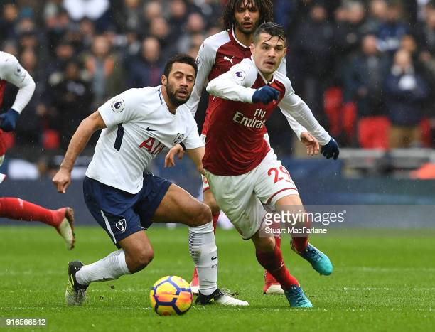 Granit Xhaka of Arsenal takes on Mousa Dembele of Tottenham during the Premier League match between Tottenham Hotspur and Arsenal at Wembley Stadium...