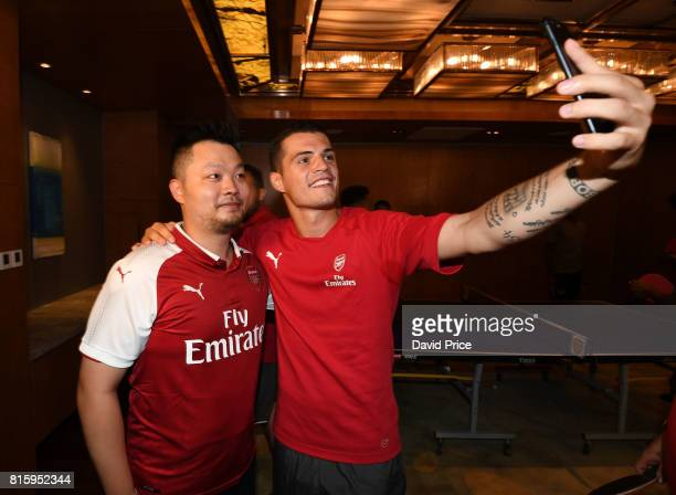 Granit Xhaka of Arsenal with a local Table Tennis teacher Li Cheng Peng during a Table Tennis exhibition in the Manderin Oriental on July 17 2017 in...