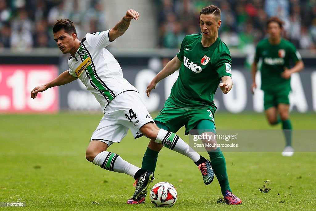 Granit Xhaka of Borussia Moenchengladbach and Dominik Kohr of FC Augsburg battle for the ball during the Bundesliga match between Borussia Moenchengladbach and FC Augsburg held at Borussia Park Stadium on May 23, 2015 in Moenchengladbach, Germany.