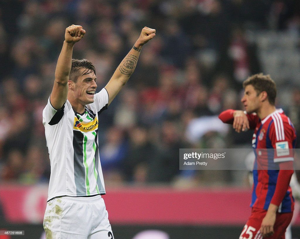 Granit Xhaka of Borussia Moenchengladbach celebrates victory in front of a dejected Thomas Mueller of FC Bayern Muenchen during the Bundesliga match between Bayern Muenchen and Borussia Moenchengladbach at Allianz Arena on March 22, 2015 in Munich, Germany.