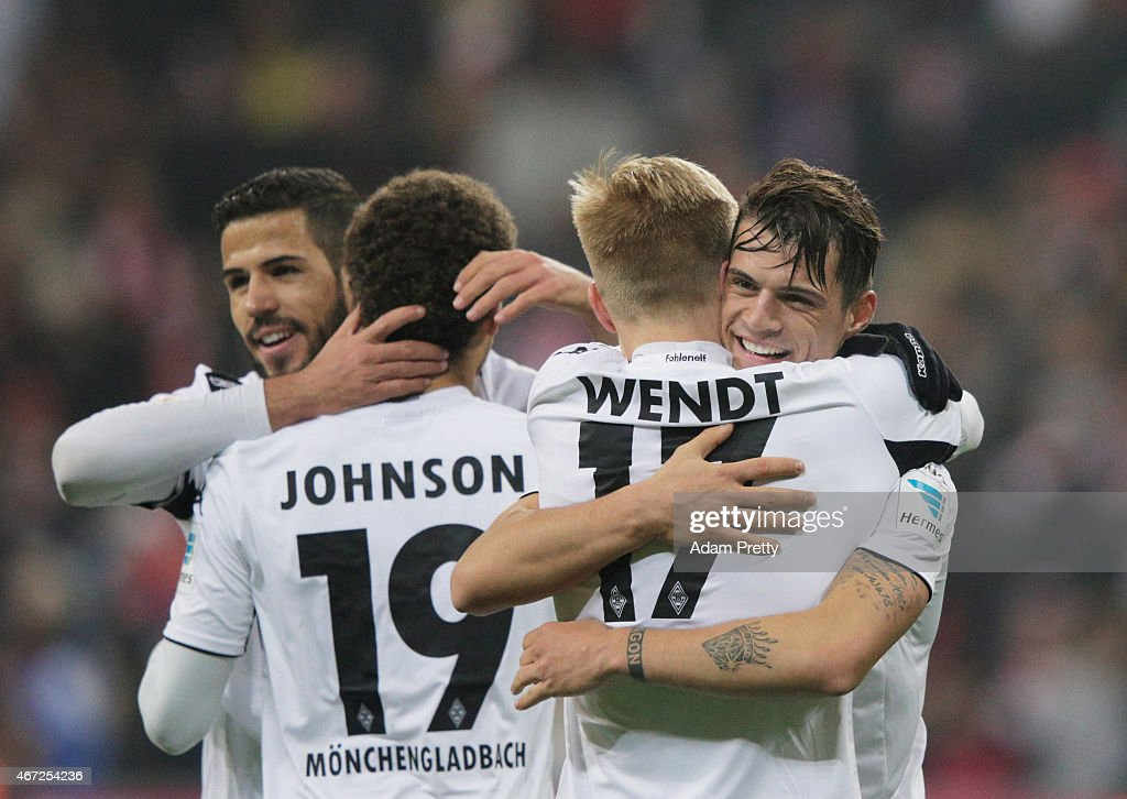 Granit Xhaka of Borussia Moenchengladbach celebrates victory with Oscar Wendt after the Bundesliga match between Bayern Muenchen and Borussia Moenchengladbach at Allianz Arena on March 22, 2015 in Munich, Germany.