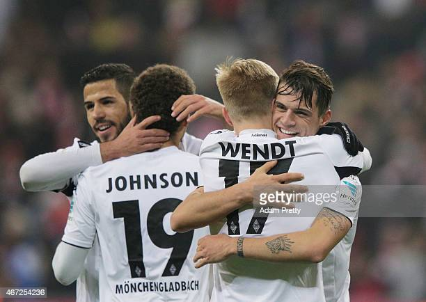 Granit Xhaka of Borussia Moenchengladbach celebrates victory with Oscar Wendt after the Bundesliga match between Bayern Muenchen and Borussia...