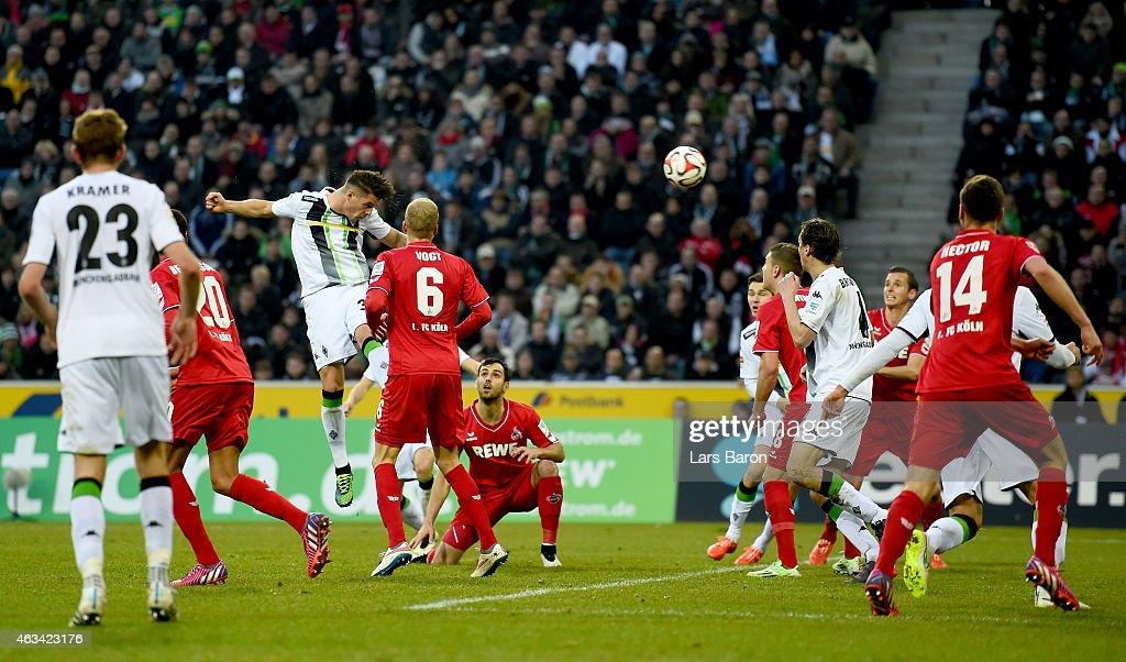 Granit Xhaka of Borussia Moenchengladbach heads his team first goal during the Bundesliga match between Borussia Moenchengladbach and 1. FC Koeln at Borussia Park Stadium on February 14, 2015 in Moenchengladbach, Germany.