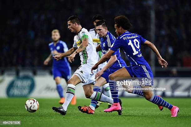 Granit Xhaka of Borussia Moenchengladbach is chased by PierreEmile Hojbjerg and Leroy Sane of FC Schalke 04 during the Bundesliga match between...