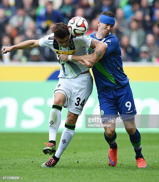 Granit Xhaka of Gladbach and Ivan Perisic of Wolfsburg compete for the ball during the Bundesliga match between Borussia Moenchengladbach and VfL...