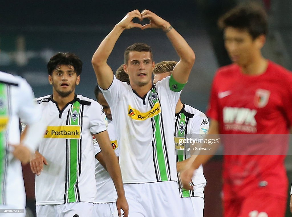 Granit Xhaka of Moenchengladbach (C) celebrates after scoring during the Bundesliga match between Borussia Moenchengladbach and FC Augsburg at Borussia-Park on September 23, 2015 in Moenchengladbach, Germany.
