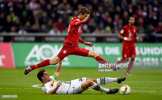 Granit Xhaka of Moenchengladbach challenges Thomas Mueller of Muenchen during the Bundesliga match between Borussia Moenchengladbach and FC Bayern...