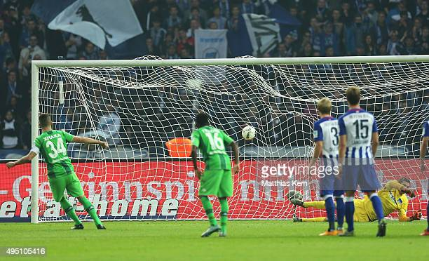 Granit Xhaka of Moenchengladbach scores the third goal after penalty during the Bundesliga match between Hertha BSC and Borussia Moenchengladbach at...