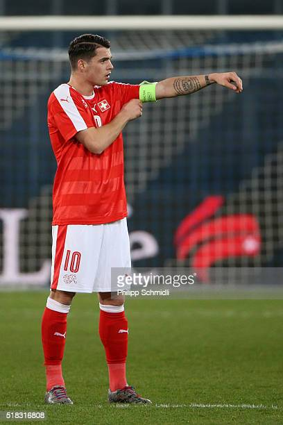 Granit Xhaka of Switzerland adjusts the captain's armband during the international friendly match between Switzerland and BosniaHerzegovina at...