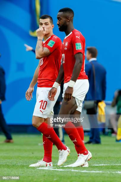 Granit Xhaka of Switzerland and Johan Djourou of Switzerland look dejected after the 2018 FIFA World Cup Russia Round of 16 match between Sweden and...