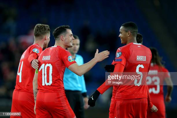 Granit Xhaka of Switzerland and Manuel Akanji of Switzerland celebrate after their team's second goal during the 2020 UEFA European Championships...