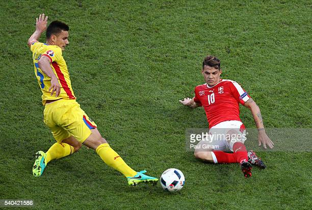 Granit Xhaka of Switzerland and Ovidiu Hoban of Romania challenge for possesion during the UEFA EURO 2016 Group A match between Romania and...