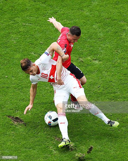 Granit Xhaka of Switzerland and Taulant Xhaka of Albania compete for the ball during the UEFA EURO 2016 Group A match between Albania and Switzerland...