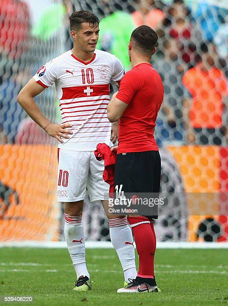 Granit Xhaka of Switzerland and Taulant Xhaka of Albania swap shirts after the UEFA EURO 2016 Group A match between Albania and Switzerland at Stade...