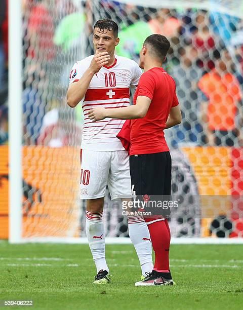 Granit Xhaka of Switzerland and Taulant Xhaka of Albania swap shirts after the UEFA EURO 2016 Group A match between Albania and Switzerland at Stade...