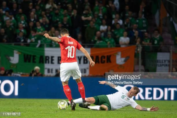 Granit Xhaka of Switzerland battles for the ball with Glenn Whelan of Republic of Ireland during the UEFA Euro 2020 qualifier between Switzerland and...