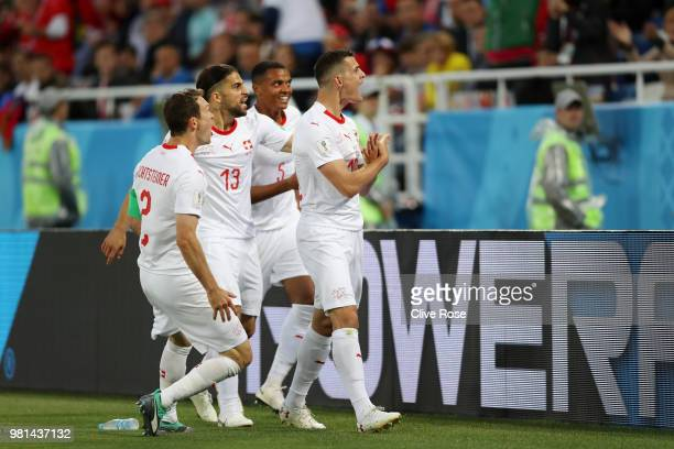 Granit Xhaka of Switzerland celebrates after scoring his team's first goal during the 2018 FIFA World Cup Russia group E match between Serbia and...
