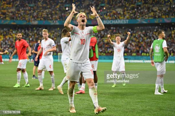 Granit Xhaka of Switzerland celebrates after victory in the penalty shoot out in the UEFA Euro 2020 Championship Round of 16 match between France and...