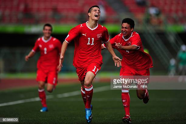 Granit Xhaka of Switzerland celebrates his goal with Charyl Chappuis during the FIFA U17 World Cup match between Switzerland and Japan at the Teslim...
