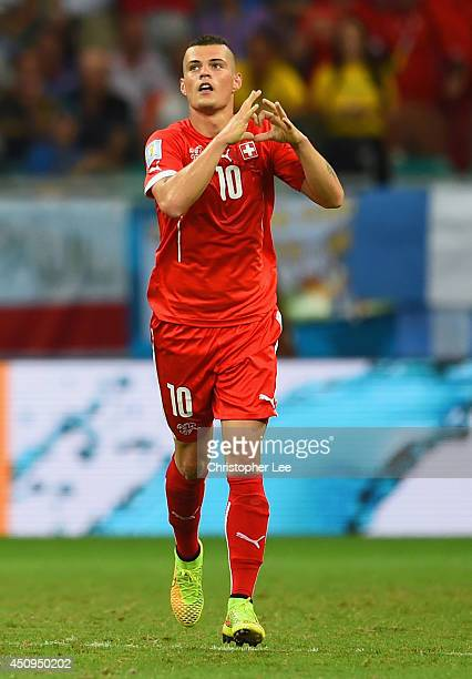 Granit Xhaka of Switzerland celebrates scoring his team's second goal during the 2014 FIFA World Cup Brazil Group E match between Switzerland and...
