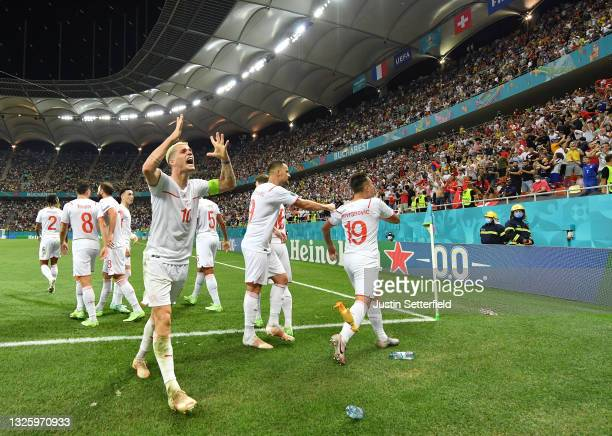 Granit Xhaka of Switzerland celebrates their side's third goal scored by team mate Mario Gavranovic during the UEFA Euro 2020 Championship Round of...