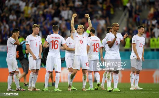 Granit Xhaka of Switzerland celebrates with teammates in the penalty shoot out during the UEFA Euro 2020 Championship Round of 16 match between...