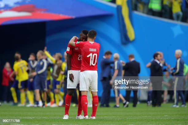 Granit Xhaka of Switzerland consoles Johan Djourou following the 2018 FIFA World Cup Russia Round of 16 match between Sweden and Switzerland at Saint...