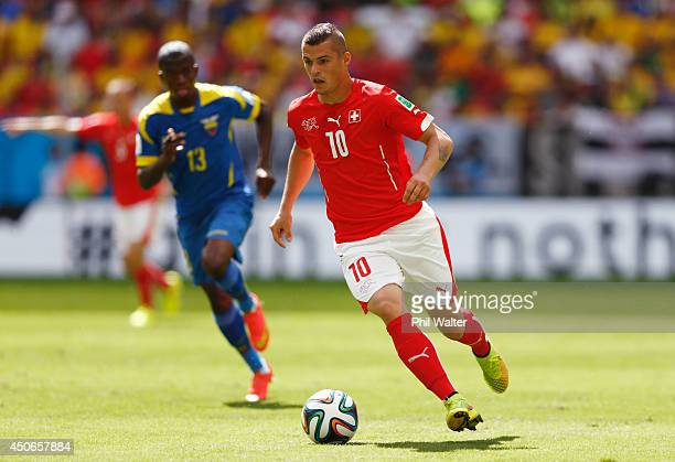 Granit Xhaka of Switzerland dribbles past Enner Valencia of Ecuador during the 2014 FIFA World Cup Brazil Group E match between Switzerland and...