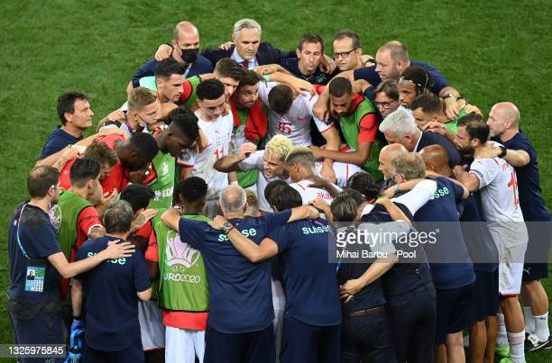 Granit Xhaka of Switzerland encourages the team before the penalty shoot out in the UEFA Euro 2020 Championship Round of 16 match between France and...
