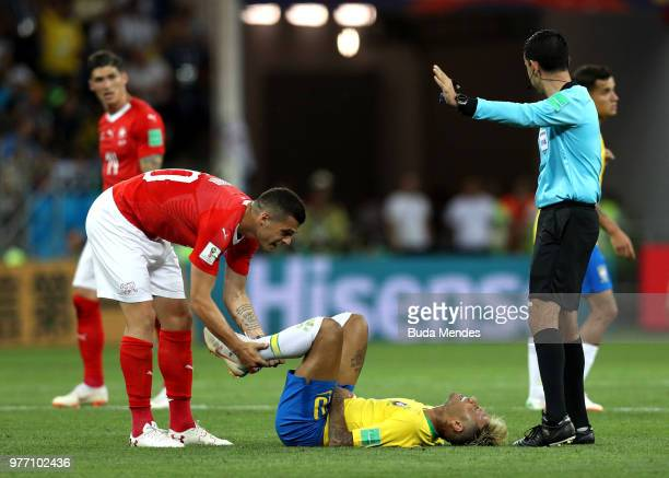 Granit Xhaka of Switzerland helps Neymar Jr of Brazil to get up during the 2018 FIFA World Cup Russia group E match between Brazil and Switzerland at...