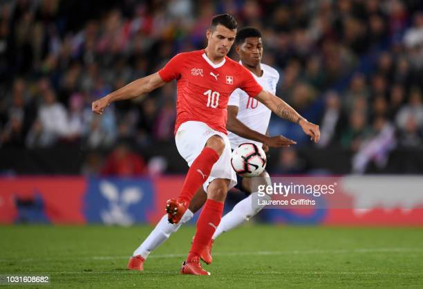 Granit Xhaka of Switzerland holds off Marcus Rashford of England during the international friendly match between England and Switzerland at The King...