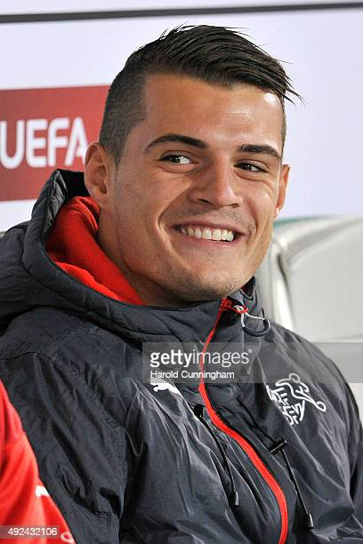 Granit Xhaka of Switzerland looks on from the bench prior to the UEFA EURO 2016 qualifier between Switzerland and San Marino at AFG Arena on October...