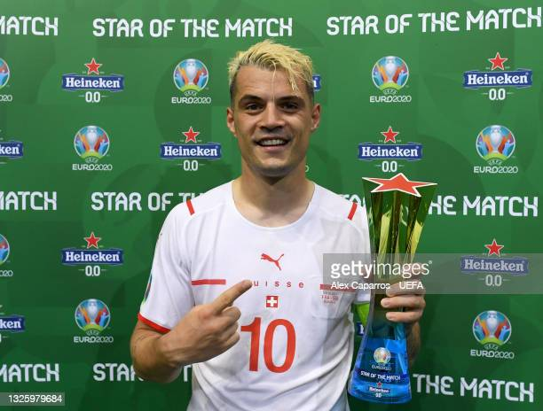 """Granit Xhaka of Switzerland poses for a photograph with their Heineken """"Star of the Match"""" award after the UEFA Euro 2020 Championship Round of 16..."""