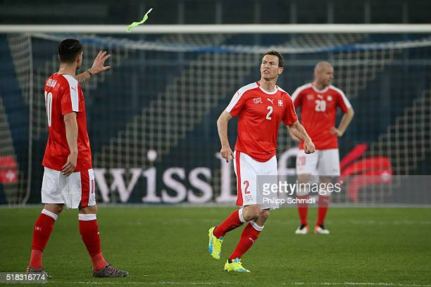 Granit Xhaka of Switzerland receives the captain's armband from Stephan Lichtsteiner during the international friendly match between Switzerland and...