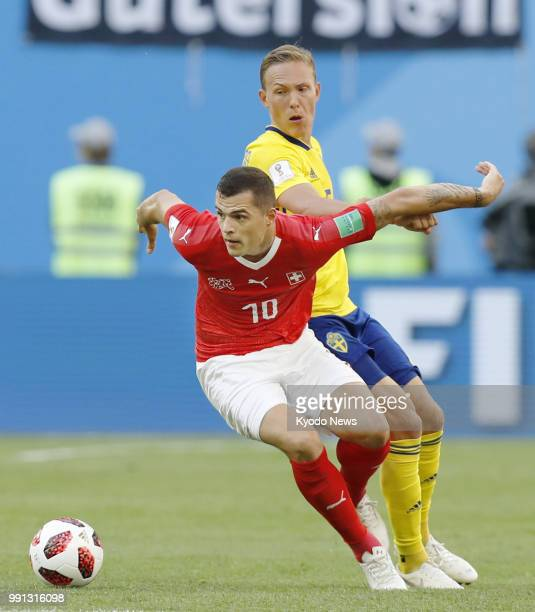 Granit Xhaka of Switzerland shields the ball from Ludwig Augustinsson of Sweden during a World Cup roundof16 match on July 3 in St Petersburg Sweden...