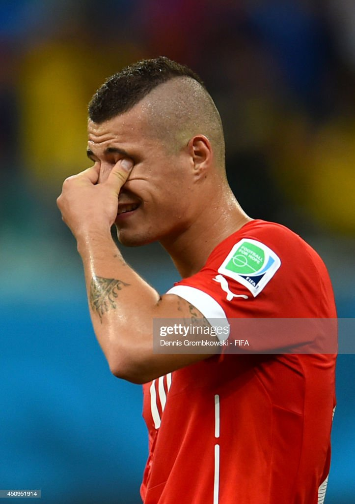 Granit Xhaka of Switzerland shows his dejection after 2-5 defeat in the 2014 FIFA World Cup Brazil Group E match between Switzerland and France at Arena Fonte Nova on June 20, 2014 in Salvador, Brazil.