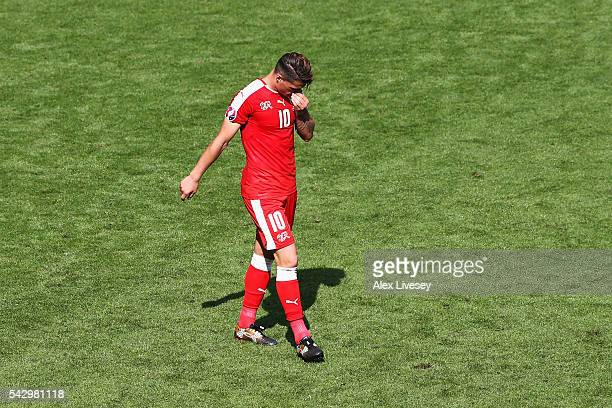 Granit Xhaka of Switzerland shows his dejection after missing a penalty kick at the penalty shootout during the UEFA EURO 2016 round of 16 match...
