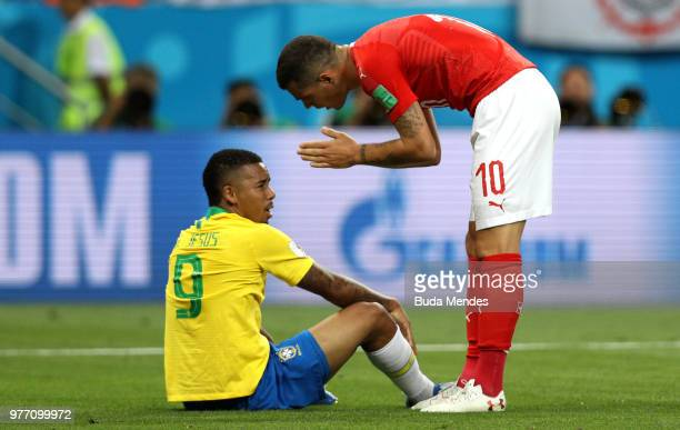 Granit Xhaka of Switzerland talks with Gabriel Jesus of Brazil after he went down in the penalty area during the 2018 FIFA World Cup Russia group E...