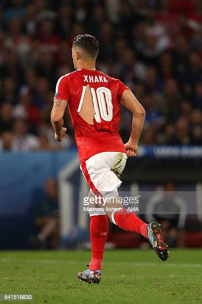Granit Xhaka of Switzerland's ripped shirt during the UEFA EURO 2016 Group A match between Switzerland and France at Stade PierreMauroy on June 19...