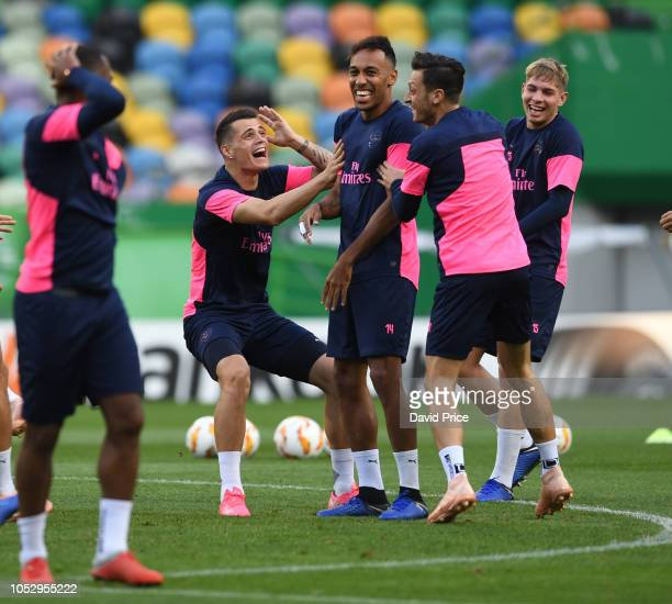 Granit Xhaka PierreEmerick Aubameyang Mesut Ozil and Emile Smith Rowe of Arsenal during the Arsenal Training Session at Estadio Jose Alvalade on...