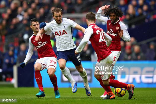 Granit Xhaka Shkodran Mustafi both of Arsenal and Harry Kane of Tottenham Hotspur in action during the Premier League match between Tottenham Hotspur...