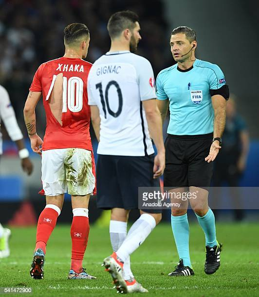 Granit Xhaka's ripped jersey is seen during the UEFA EURO 2016 Group A match between Switzerland and France at Stade PierreMauroy in Lille France on...
