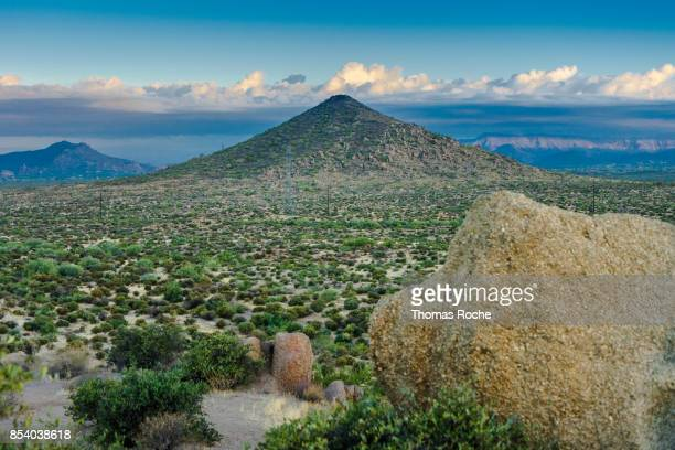 a granite boulder in the sanoran desert landscape - sonoran desert stock pictures, royalty-free photos & images